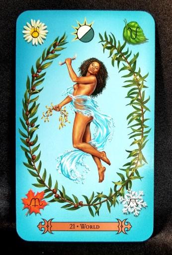 The World - Tarot Card:  A beautiful woman draped in waves