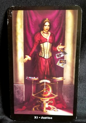 Justice - Tarot Card - a woman in a red dress in front of a steampunk scale
