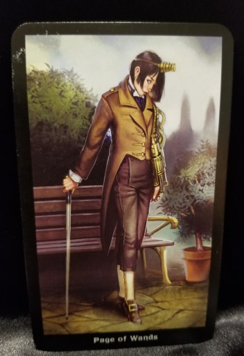 Page of Wands - Tarot: A well dressed young man holding a cane