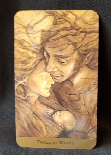 Three of Wands - A Man and woman embracing their small baby