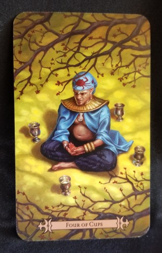 Four of Cups - Tarot  Card: A man dressed like a Genie sitting in contemplation surrounded by four cups