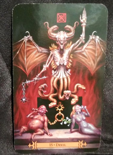 Devil - Tarot Card:  A large Deveil standing over demons of glutony and sloth