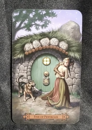 Five of Pentacles - Tarot card:  A woman and man fleeing from an angry, barking dog.