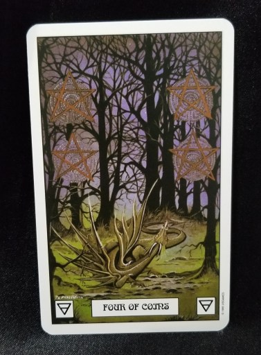 Four of Coins - Tarot Card: A green dragon in a deep forest. looking up at 4 pentacle coins.