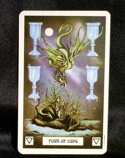Four of Cups - Tarot Card:  A flying green dragon reaching down towards another dragon resting on a rock. Four white chalices flank the dragons.