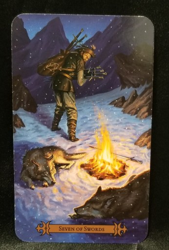 "Seven of Swords - Tarot Card""  A man holding seven swords standing next to a campfire, a wolf at his feet."