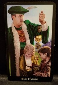 Six of Pentacles - Tarot Card:  a man in medieval garb dropping pentacle coins into the hands of a little boy and girl.