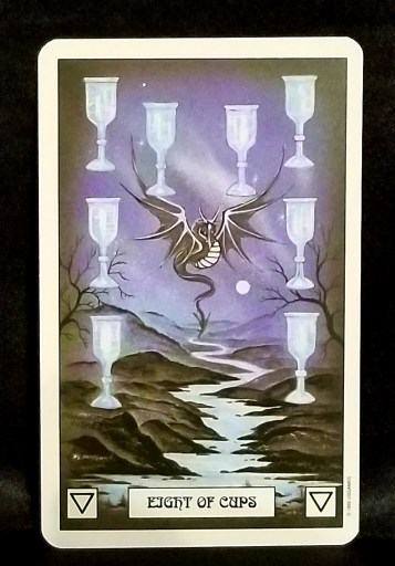 Eight of Cups- A silver dragon hovering over a river.  Eight Silver chalices surround him on all sides