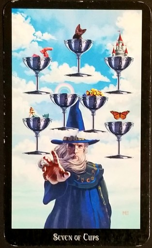 Seven of Cups- A Magician holds his hand out towards you.  Seven cups containing various objects are in the clouds above him.