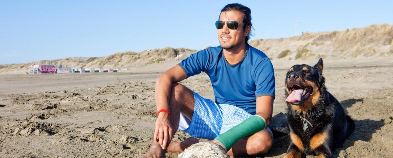 Man sitting on beach with Benecast