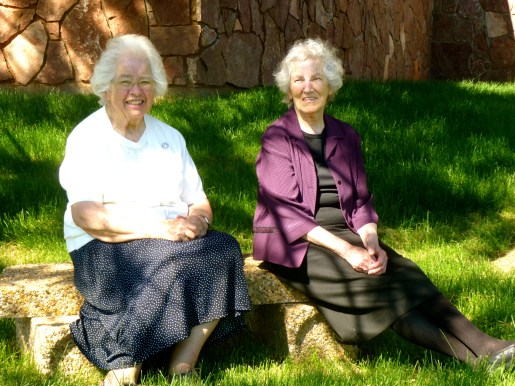 Sisters Florence and Carol find a shady place to sit