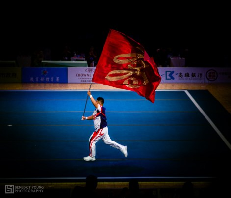 26 Taiwan's Cheerleaders Hoisting and Unfamiliar Flag (by Benedict Young)