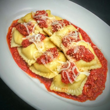 RAVIOLI - House crafted three cheese ravioli filled with fresh herbs and assorted cheese