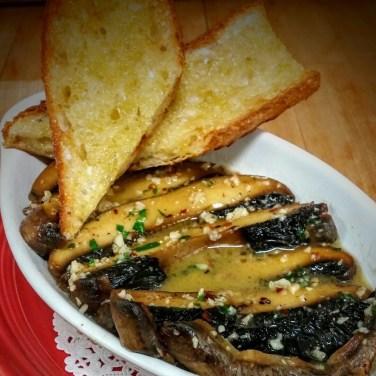 PORTOBELLO MUSHROOMS sauteed in a garlic butter wine sauce