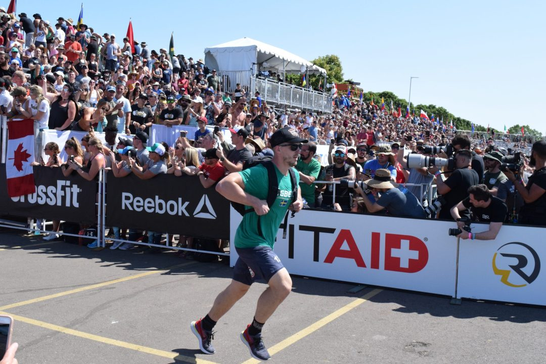 Lukas Högberg of Sweden completes the Ruck Run event at the 2019 CrossFit Games