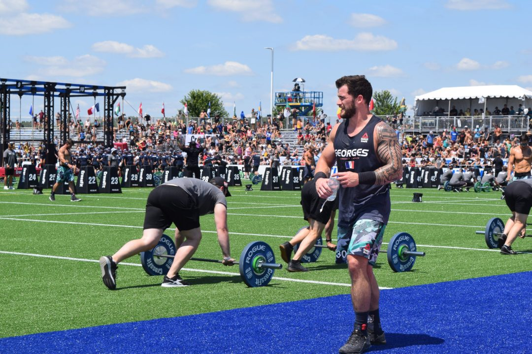 Willy Georges walks off the field after the first event of the 2019 CrossFit Games