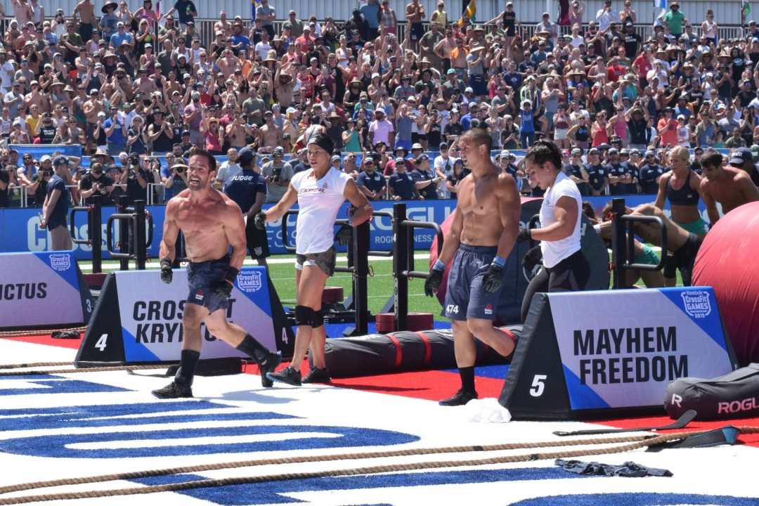 Rich Froning and CrossFit Mayhem Freedom cross the finish line of an event at the 2019 CrossFit Games.