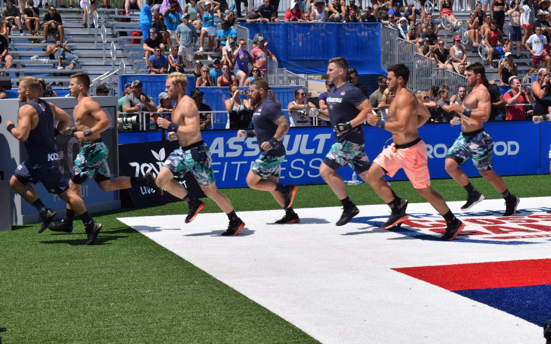 Patrick Vellner, Matt McLeod run into the tunnel at the first event of the 2019 CrossFit Games. Image courtesy of WODDITY.