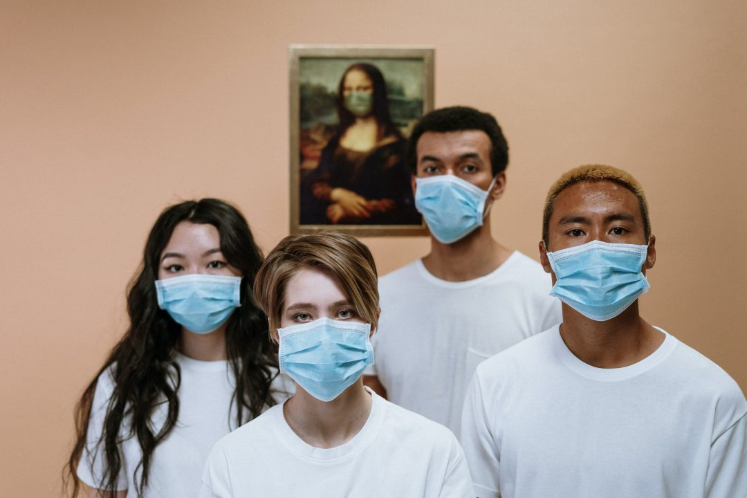 Students wearing masks in an art installation during the COVID-19 pandemic.