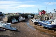 boats_at_low_tide_in_hall__s_harbour_ns_by_benny007-d5fy2k1