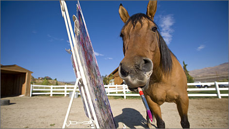Cholla in his plein air studio posing for the photographer.