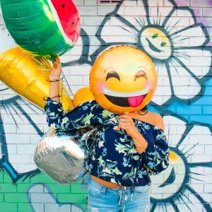 Woman with Emoji Balloon on Benjamin Preston's website