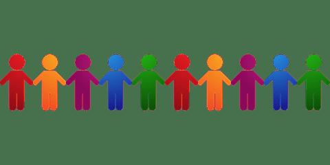 Iconos de figuras humanas de diferentes colores para mostrar diversidad, tomadas de la mano.