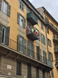 Many balconies had wet clothes drying on them.