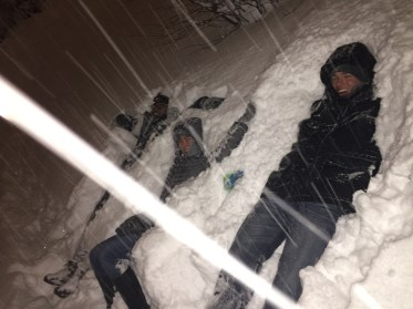 Taking a break and laying in the snow.