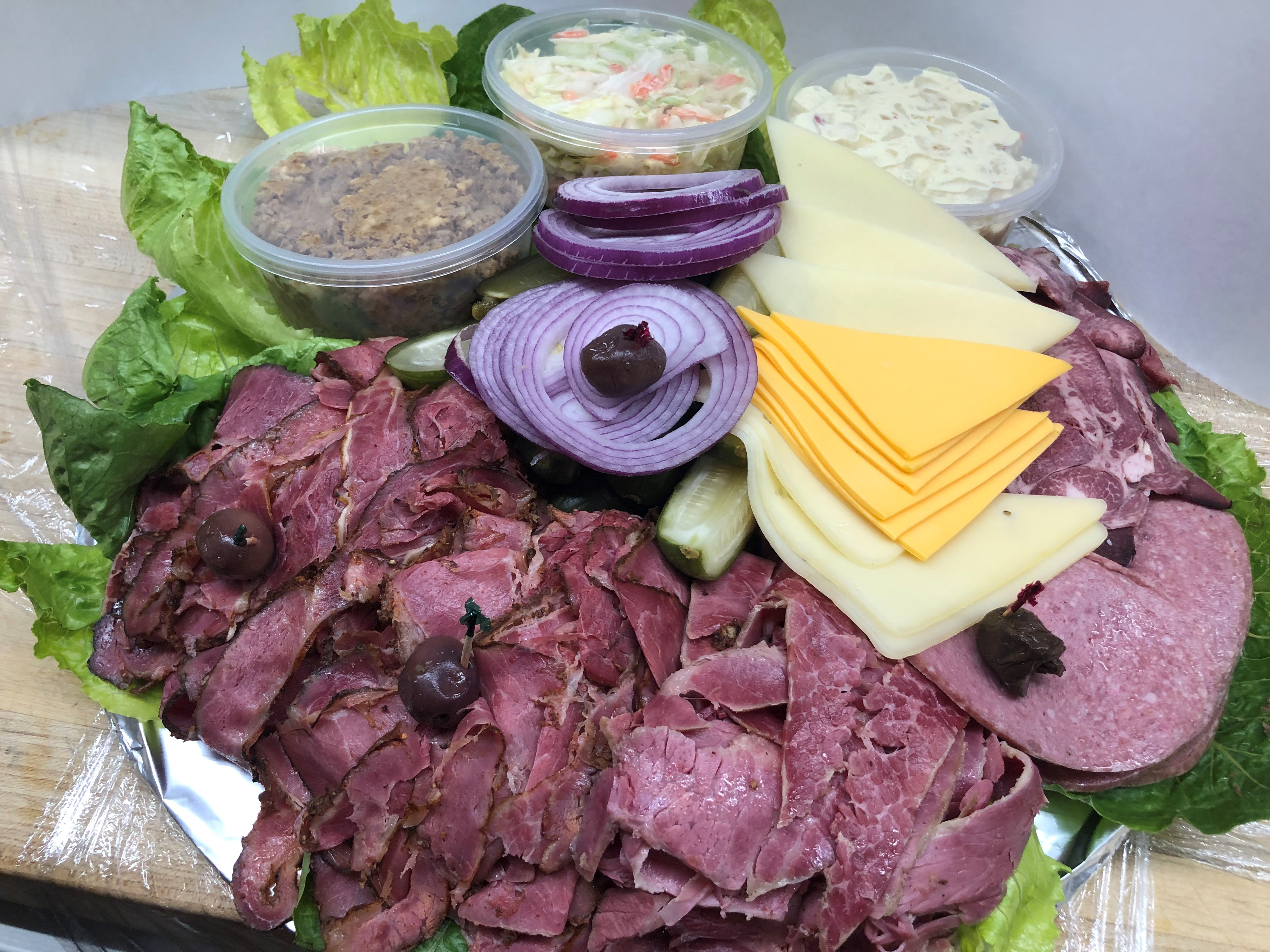 Catering with the Deli Feast. A beautiful ensemble of meats and cheese for feed an army. An OC classic.