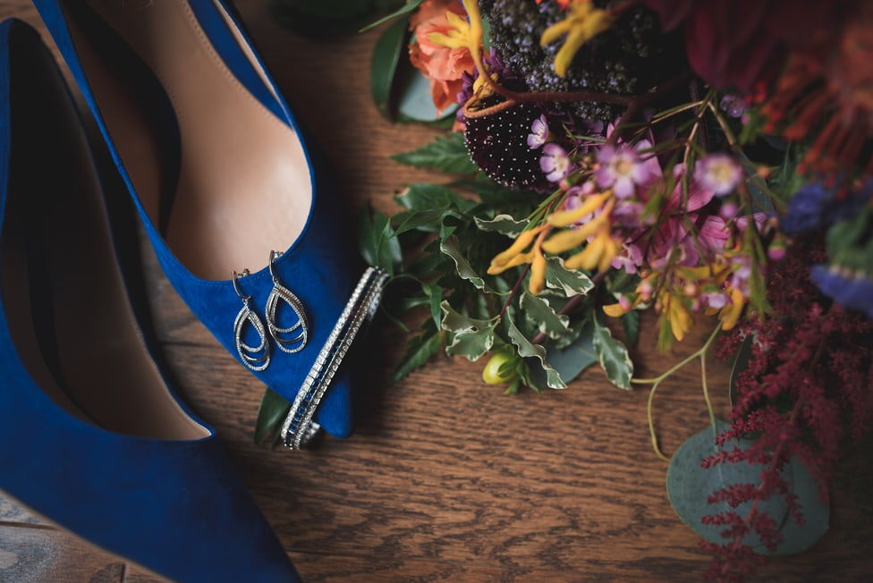 Bridal details, including royal blue shoes, jewellery and bouquet by Designs by Cate