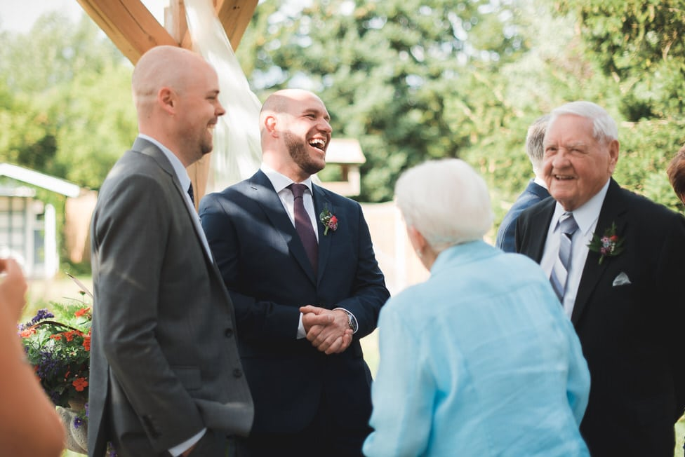 groom and guests laughing