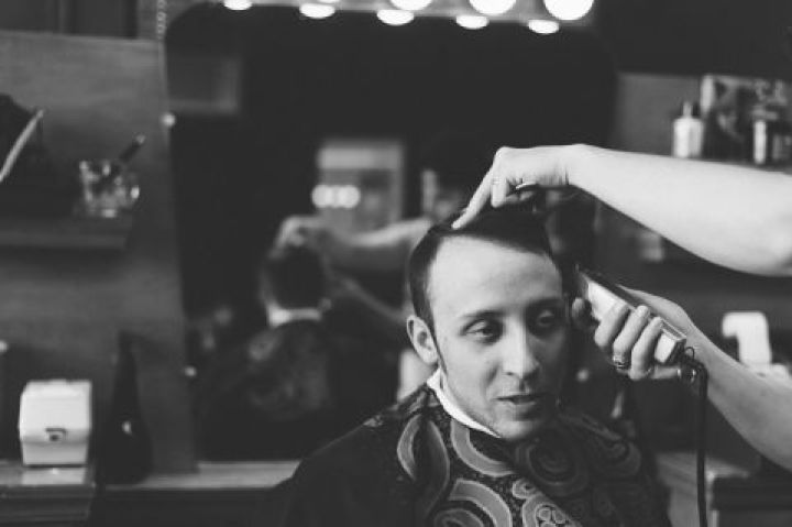 Groom gets a haircut on the morning of his wedding day at Kirkpatrick Chapel in New Brunswick, NJ. Captured by Central Jersey Wedding Photographer Ben Lau.
