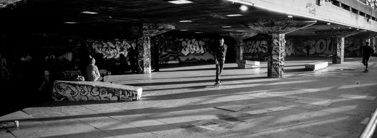 skaters on the thames southbank in black and white, taken using a hasselblad xpan