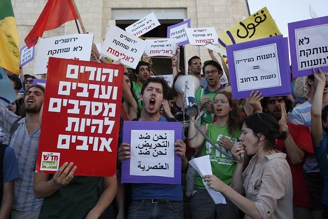 Israeli leftists protest a Jerusalem Day march on 17 May 2015. CREDIT: AFP/Gali Tibbon