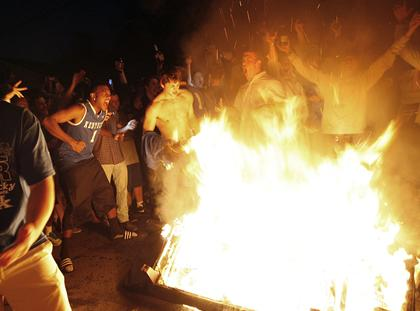University of Kentucky thugs rioting and engaging in senseless acts of violence after their school won a basketball game in 2012 CREDIT: AP/Amy Wallot