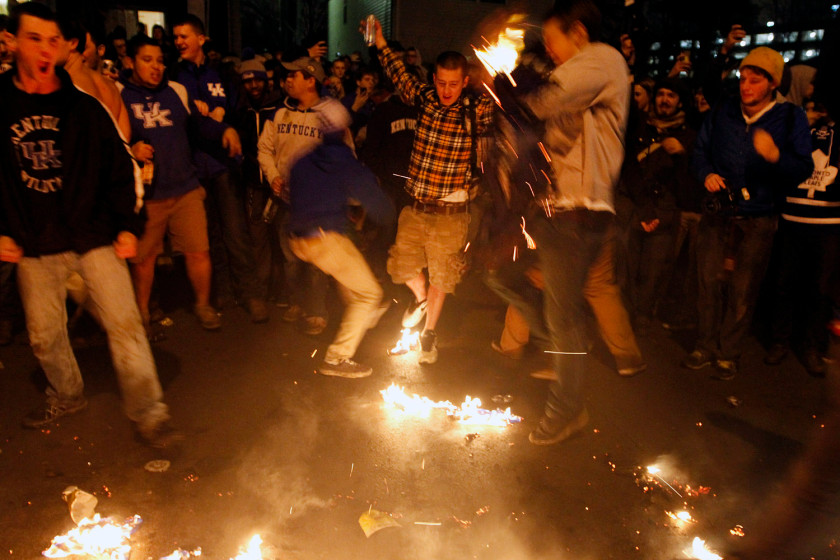 University of Kentucky thugs rioting and engaging in senseless acts of violence after their school lost a basketball game CREDIT: AP/The Courier-Journal/James Crisp