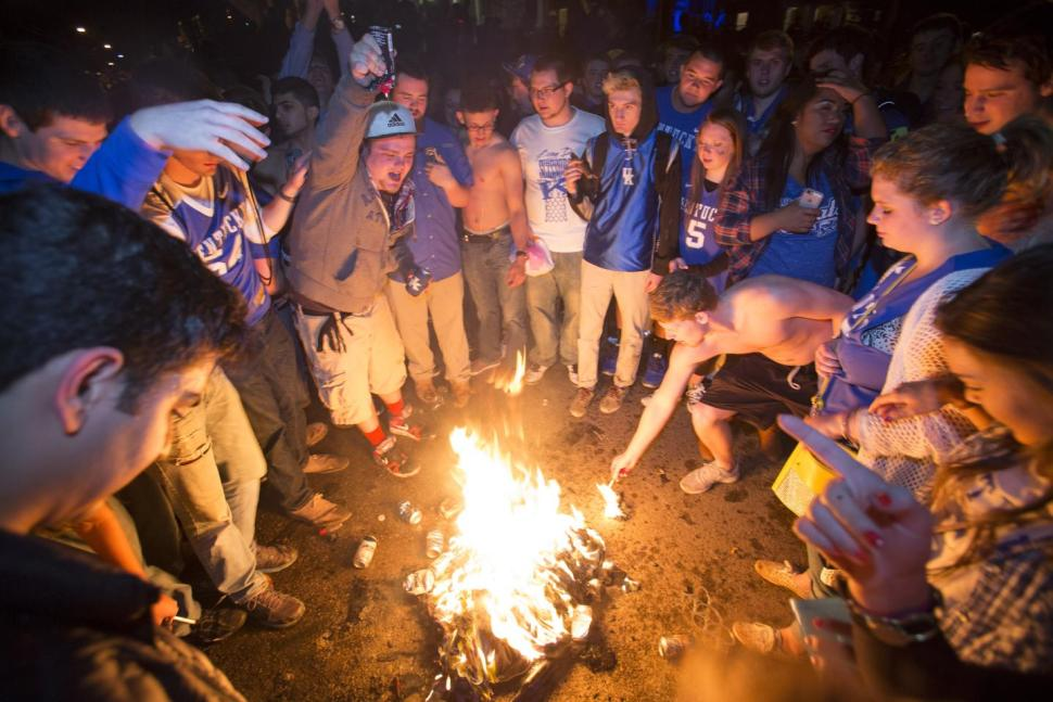 University of Kentucky thugs rioting and engaging in senseless acts of violence after their school lost a basketball game in 2015 CREDIT: AP/David Stephenson