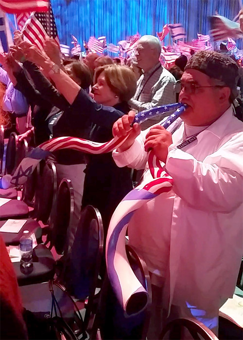 A CUFI attendee with a US/Israeli flag shofar