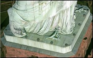 Broken shackles at the feet of the Statue of Liberty