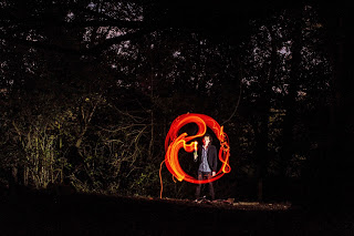 Ben by firelight  - photo by Mike Gilpin and Benjamin Akira Tallamy