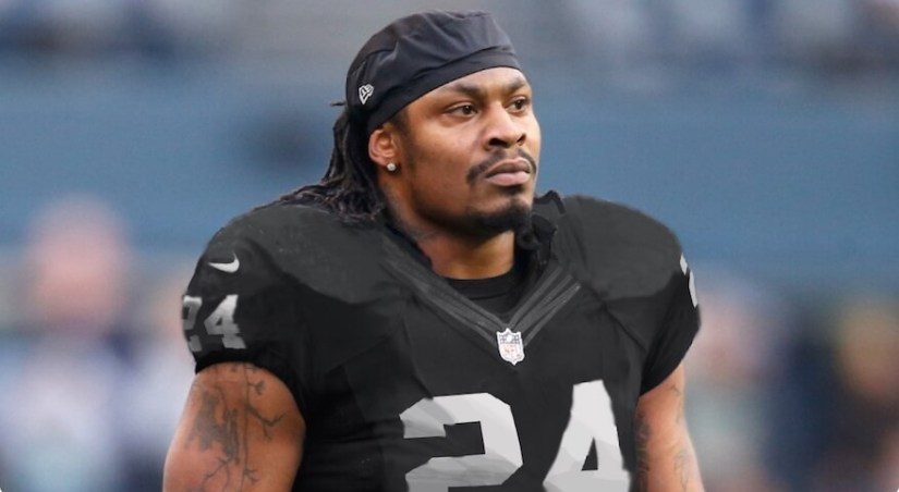 Marshawn Lynch sits for U.S. anthem, stands for Mexican anthem