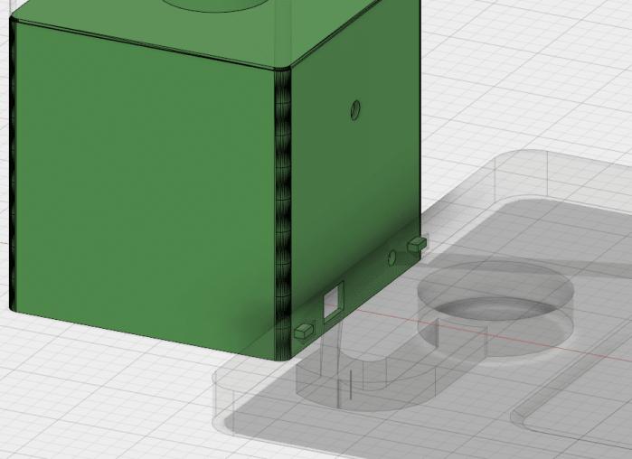 La partie lampe s'encastre dans le plateau de recharge. On aperçois également les passages de fils entre les deux éléments.