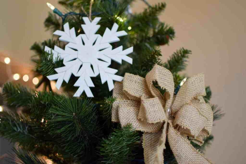 Snowflake and burlap bow on christmas tree