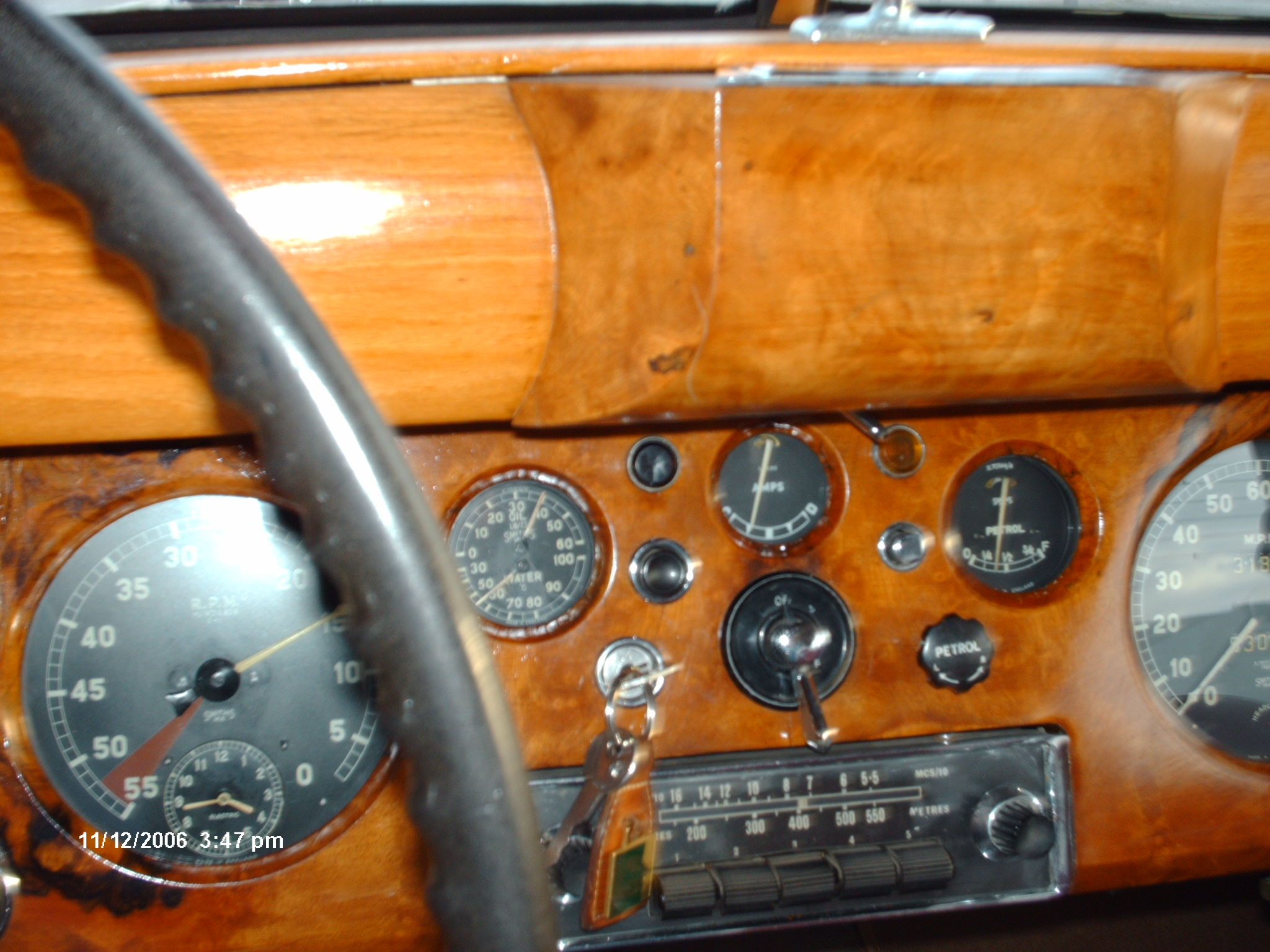 Walnut dashboard with period black dialled instruments.