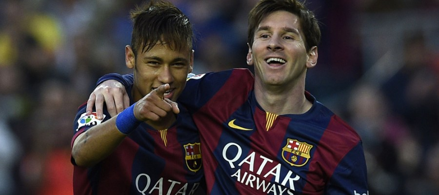 Barcelona's Brazilian forward Neymar da Silva Santos Junior (L) and Barcelona's Argentinian forward Lionel Messi (R) celebrate after scoring a goal during the Spanish league football match FC Barcelona vs Getafe at the Camp Nou stadium in Barcelona on April 28, 2015.   AFP PHOTO/ LLUIS GENE