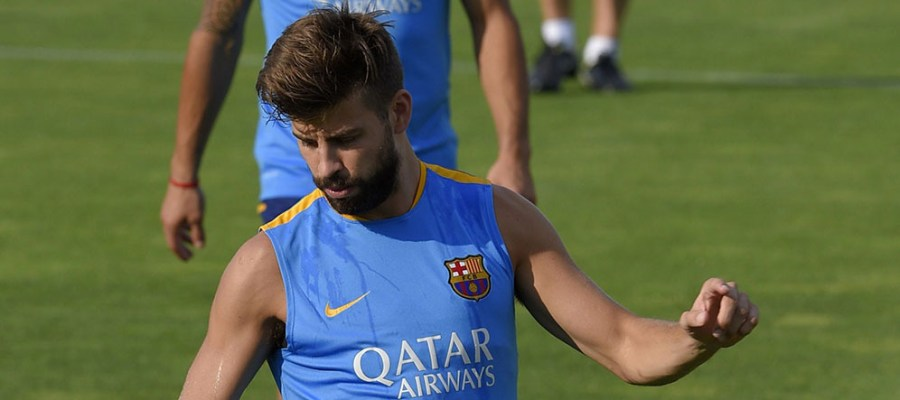 Barcelona's defender Gerard Pique kicks a ball during a training session at the Sports Center FC Barcelona Joan Gamper in Sant Joan Despi, near Barcelona on July 15, 2015. AFP PHOTO/ LLUIS GENE