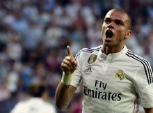 Real Madrid's Portuguese defender Pepe celebrates after scoring during the Spanish league football match Real Madrid CF vs Valencia CF at the Santiago Bernabeu stadium in Madrid on May 9, 2015.   AFP PHOTO/ GERARD JULIEN