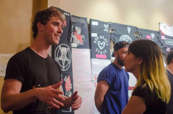Rob of Don Broco meeting fans by the merch table