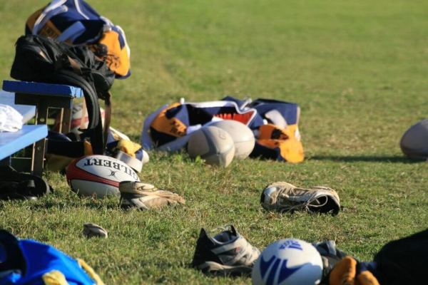 Rugby equipment strewn across a field